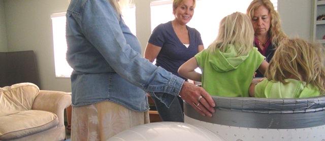 Mom, twins and two facilitators at BEBA Santa Barbara clinic engaged in play therapy.